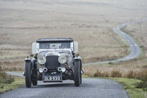 George Howitt & Monigue Rombouts heading across the moors in their 1934 Aston Martin by Gerard Brown